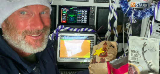 Reindeer and gingerbread shorten the time of Finnish solo skipper Ari Huusela (58) in his cockpit